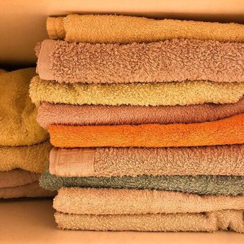 In the kitchen -  Use an old towel to make rags instead of buying single-use paper towels